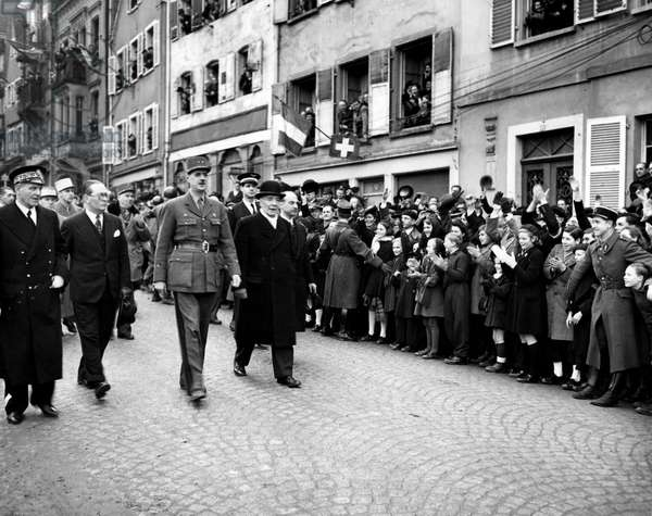 Second (Second) World War (1939-1945) - World War II (WWII or WW2): Saverne (France) 11 February 1945: After the ceremony in which he decorated many American senior officers, General de Gaulle returns his car accompanied from left to right by Mr. Matter (deputy prefet), Mr. Diethelm (Minister of War) and the mayor of city