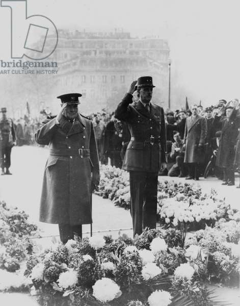 Second World War (1939-1945) - World War II (WWII or WW2): Paris, France 11 November 1944: During the celebration of the 1918 Armistice, British Prime Minister Winston Churchill and General De Gaulle put a wreath of flowers on the Tomb of the Unknown Soldier under the Arc de Triomphe