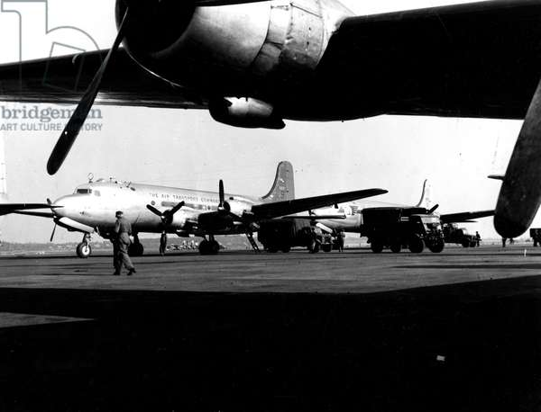 Blockade of Berlin by russian - Berlin Blockade (1948-1949): Gatow Airport (Berlin) Germany autumn 1948. During the blockade of the city by the Sovietic authorities and Operation Vittles (Victuailles), USAF C54 destined to deliver food to the German capital were prepared to be discharged from their cargo. The three western areas were supplied by an unceasing air bridge. This blockade will last from 24 June 1948 to 12 May 1949