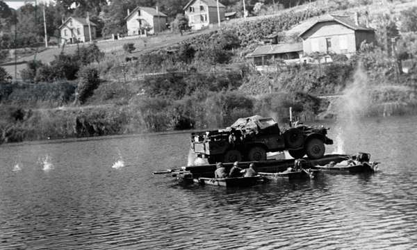 Second World War (1939-1945) - World War II (WWII or WW2): Near Montereau (Seine and Marne) August 24, 1944: Soldiers of the 5th D.I US cross the Seine under enemy fire