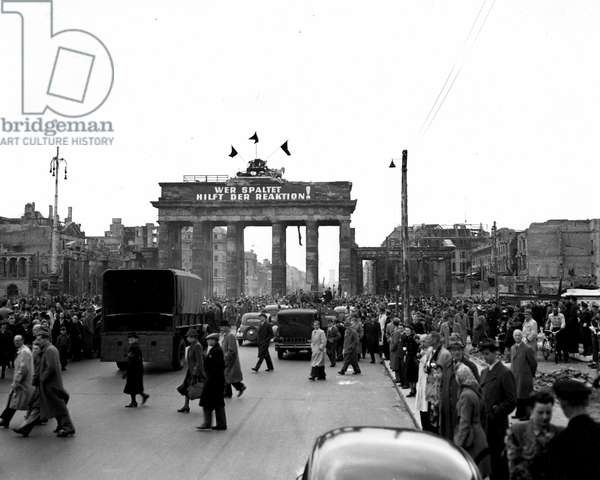 Blockade of Berlin by english - Blockade of Berlin (1948-1949): Berlin (Germany) 1 May 1948. On Labour Day, the Brandenburg Gate separates Communist and anti-Communist demonstrators. This photograph is taken from the British sector shows some of the demonstrators turning left towards the ruins of the Reichtag while the Communist demonstrators go to the Sovietic sector.