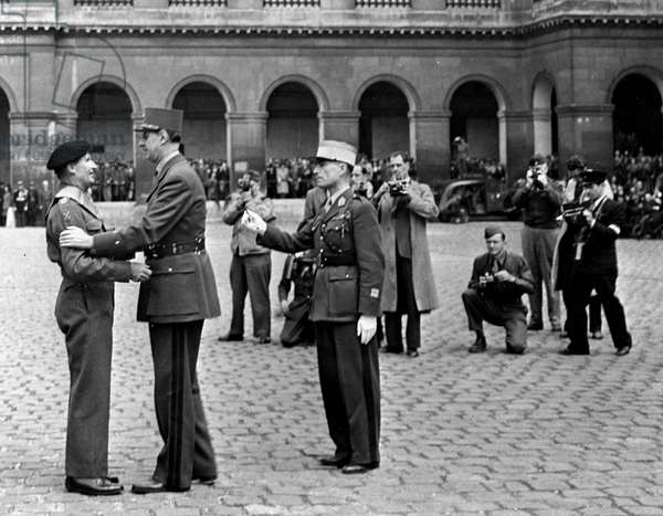 Second World War (1939-1945) - World War II (WWII or WW2): Paris (France) May 25, 1945: In the Cour des Invalides, General De Gaulle decorates the British Marechal Sir Bernard L.Montgomery of the Grand Cross of the Legion d'Honneur