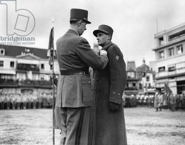 Second World War (1939-1945): Colmar (Alsace) France 10 February 1945: General De Gaulle decorates a young brigadier general of the 1st French Armee who took part in the fighting for the liberation of the city