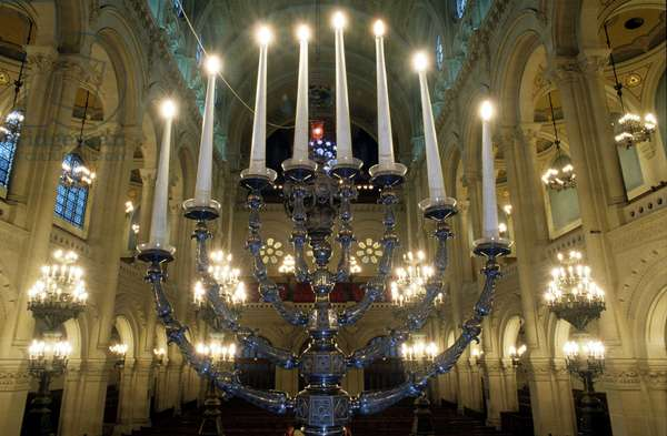 Chandelier has eight branches. Interior of the synagogue Rue de la Victoire in the 9th arrondissement of Paris.