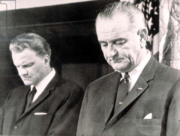 Billy Graham & President Lyndon B. Johnson in prayer at the White House, 1964