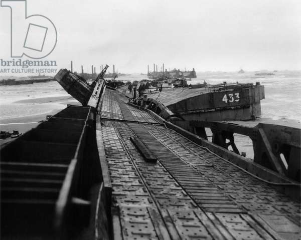 Twisted metal of 'Mulberry A', an artificial harbor at Omaha Beach. A storm on June 19-22, 1944, wrecked the harbor beyond repair, contributing to Allies' supply problems throughout 1944. Normandy, France, World War 2