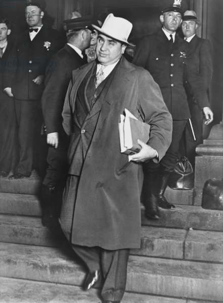 Al Capone, winks at photographers as he leaves Chicago's federal courthouse. October 14, 1931. The notorious Chicago gangster was on trial for tax evasion.