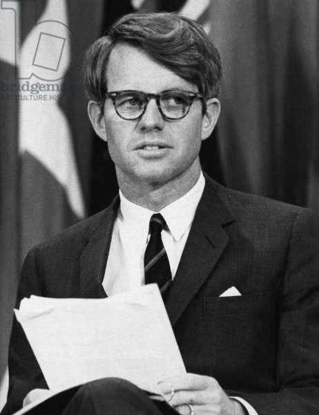 Senator Robert F. Kennedy waits to address 14,500 students at Kansas State University, March 25, 1968.