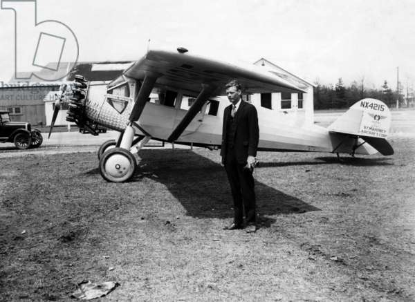 America pilot Charles Lindbergh, with his new monoplane in the background at Curtis Field, Long Island, New York, 1928.