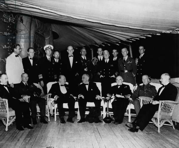 President Franklin D. Roosevelt (front, center), and Winston Churchill (front, left of center) aboard the U.S.S. Augusta, during the Atlantic Charter conferences, August 15, 1941