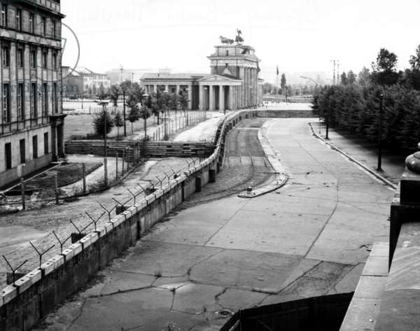 The Berlin Wall against the background of Brandenburg Gate in the heart of the city. Berlin, Germany. 1962