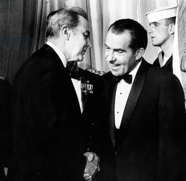 President Richard Nixon shakes hands with Sen. Eugene McCarthy at a White House reception for Congress, March 12, 1969