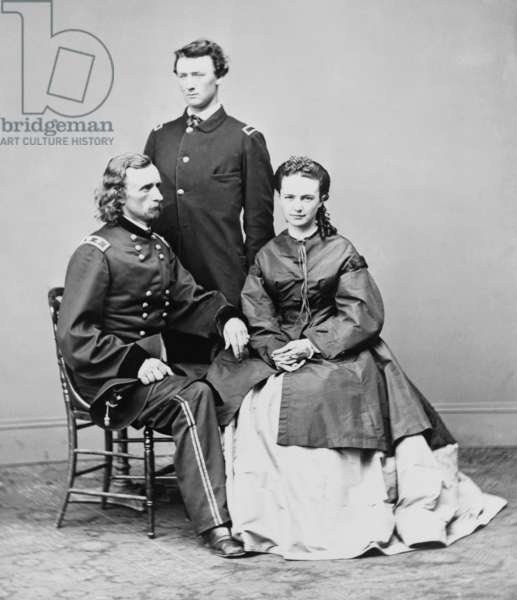 George Armstrong Custer, seated with his wife Elizabeth and his brother, Thomas W. Custer. Several movies have been based on his military exploits and death at the Battle of Little Bighorn. Errol Flynn played Custer in the 1941 movie, THEY DIED WITH THEIR BOOTS ON