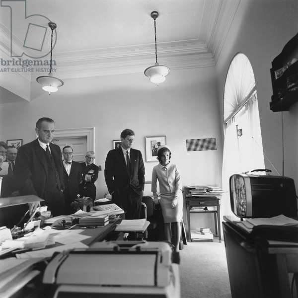 John Kennedy and others watching the first manned U.S. space flight of Astronaut Alan Shepard, on television in the White House West Wing. Left to right: Attorney General Kennedy, McGeorge Bundy, Vice President Johnson, Arthur Schlesinger, Admiral Arleigh