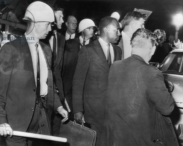 US Civil Rights. Right center: James H. Meredith, being escorted by federal marshals upon arriving at the University of Mississippi to register for classes, Oxford, Mississippi, September, 1962