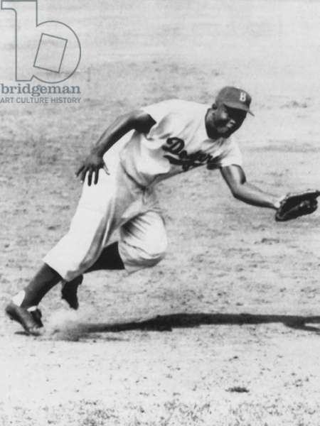 Jackie Robinson, fielding third base for the Brooklyn Dodgers, 1954