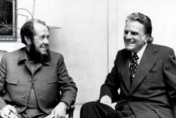 Soviet author Alexander Solzhenitsyn and evangelist Billy Graham discuss world religious trends suring a metting in Stockholm, Sweden. December 1974.