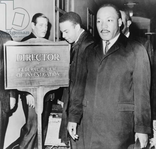 MLK enters the FBI Building. Dr. Martin Luther King, Jr. and Andrew Young arriving at the FBI to meet with FBI Director J. Edgar Hoover. Their discussion addressed King's comments about FBI cooperation with Southern segregationists and local police. Dec. 1, 1964