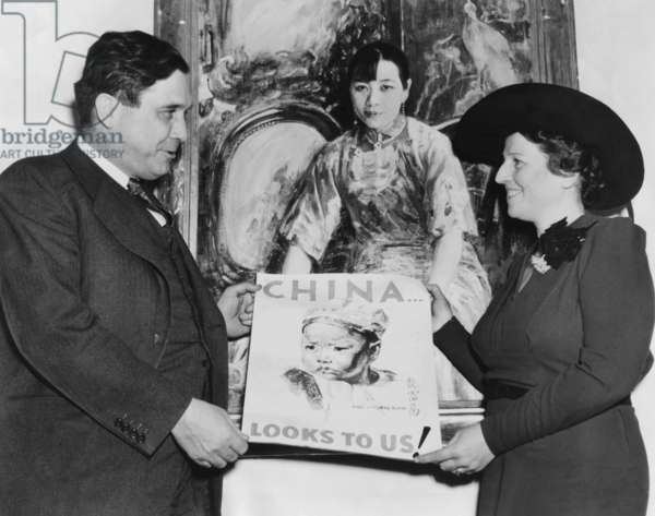 Wendell Willkie, Director of United China Relief with Pearl Buck. They present the poster to be used in a drive for  million for Chinese relief