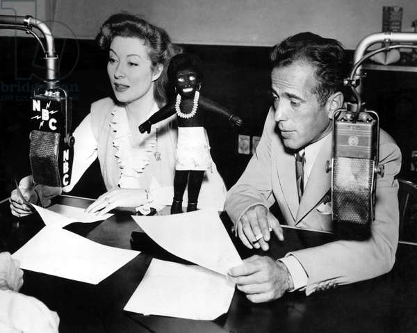 N.B.C.'s ARMY HOUR, Greer Garson, Humphrey Bogart with the Fuzzy Wuzzy Award which was the GI version of the Oscar presented to them, 1944