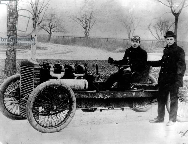 "Henry Ford with driver Barney Oldfield in ""Old 99"", an early Ford racing car, 1902"