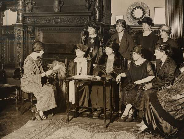 American Alice Paul, leader of the militant National Women's Party meeting with English feminists at American Woman's Club in London. (l to r) Alice Paul, Elizabeth Robins, Viscountess Rhondda, Dr. Louisa Martindale, Mrs. Virginia Crawford, Dorothy Evans, Standing: Emmeline Pethick-Lawrence, Alison Neilans, Florence Underwood, Miss Barry
