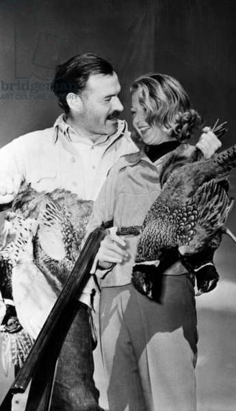 Ernest Hemingway and Martha Gellhorn on a shooting expedition. c. 1940.