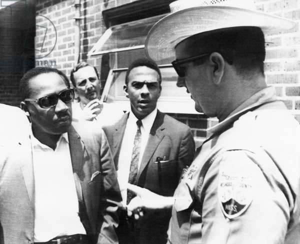US Civil Rights. Far left: Dr. Martin Luther King, Jr. Far right: Neshoba County Deputy Sheriff Cecil Price, confronting each other after a civil rights demonstration in memory of two murdered civil rights workers, Philadelphia, Mississippi, June 1966