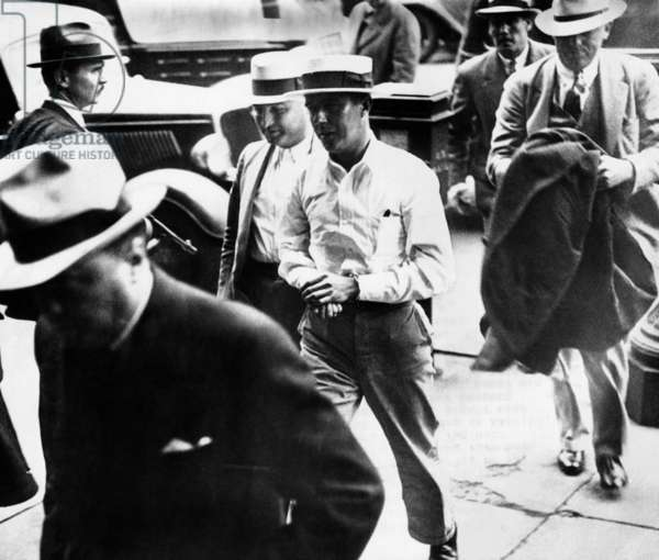 Alvin Karpis, 'Public Enemy No. 1', walks behind his captor, J. Edgar Hoover, director of the FBI, (at left) into Federal Court in St. Paul, Minn. May 03, 1936