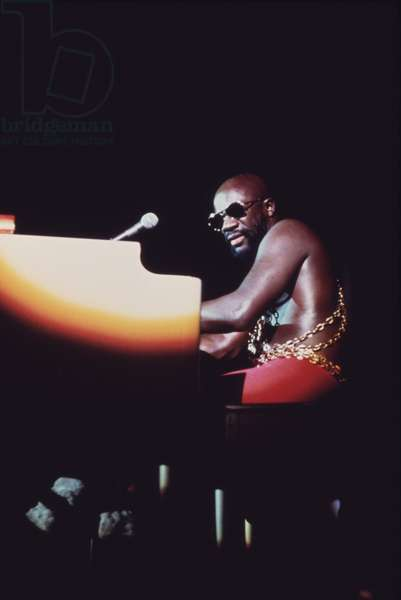 Isaac Hayes performs in Chicago during the annual 'Black Expo' organized by Operation Push the African American non-profit organized by Jesse Jackson. Oct 1973