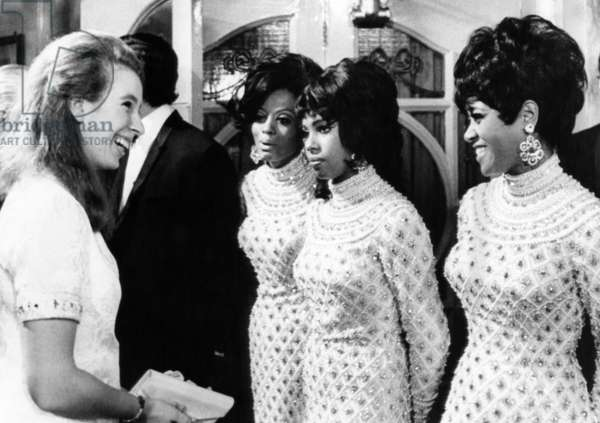Princess Anne talks with The Supremes (Diana Ross, Mary Wilson, Cindy Birdsong) after a concert at London's Palladium, 1968