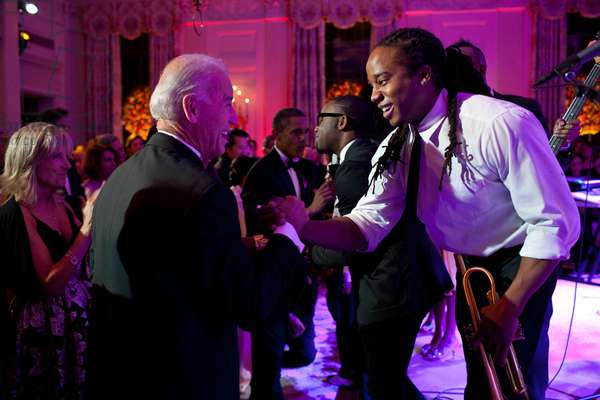 Vice President Joe Biden greets Lance Powlis, a trumpet player in Janelle Monae's band. The group performed in the State Dining Room of the White House, Oct. 13, 2011
