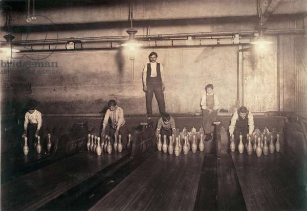 Child labor, pin boys at a bowling alley, from original caption: '1:00 A.M. pin boys working in subway bowling alleys, 65 South Street, Brooklyn, every night. Three smaller boys were kept out of the photo by Boss', Brooklyn, New York, photograph by Lewis Wickes Hine, April, 1910