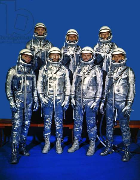 Project Mercury astronauts in their space suits. Front row, left to right, Walter H. Schirra Jr., Donald K. Slayton, John H. Glenn Jr., and Scott Carpenter; back row, Alan B. Shepard Jr., Gus Grissom, and L. Gordon Cooper. 1959