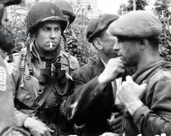 French civilians with American paratroopers who jumped into Normandy on D-Day, June 6, 1944. France, World War 2
