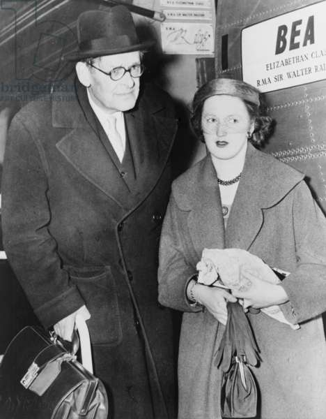 T.S. Eliot (1888-1965), American born English poet, and his wife, the former Miss Valerie Fletcher, arrive at London Airport from Nice after honeymoon in 1957
