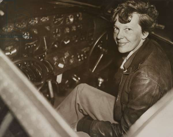 Amelia Earhart sitting in the cockpit of her Lockheed Electra airplane, c. 1936. In July 1937 Earhart and the airplane were lost over the Pacific Ocean