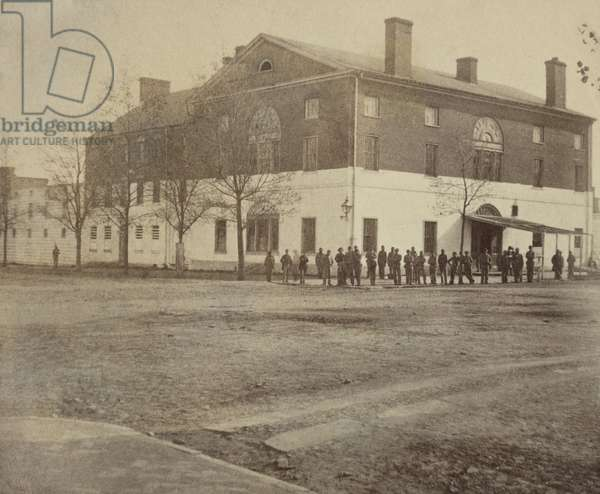 Old Capitol prison, Washington, D.C. 1861-65. It previously served as the temporary Capitol of the United States from 1815 to 1819, then as a boarding house, and school. During the US Civil War, it was a prison for captured Confederates, political prisoners, spies, misbehaving Union officers, prostitutes, and finally, some suspects of the assassination of President Lincoln. Before its demolition in 1929, it housed the headquarters of the National Woman's Party