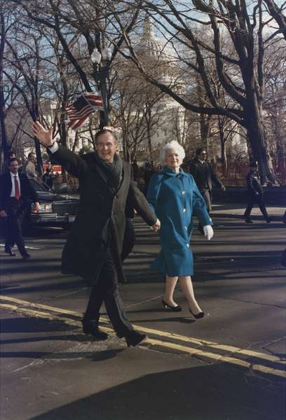 President George and Barbara Bush walk along Pennsylvania Avenue after the President's Inauguration. Jan. 20 1989