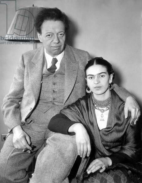 Photo shows Diego Rivera and his wife Frida Kahlo in their apartment in the Barbizon Plaza Hotel in New York, the day after his dismissal from painting the Rockefeller Center mural. 5/10/33.