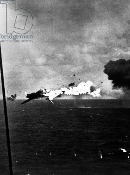 Japanese bomber explodes after direct hit by 5 inch shell from USS Yorktown, Dec. 4, 1943. Off Kwajalein Atoll. World War 2, Pacific Ocean