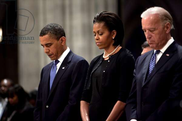 President Barack Obama First Lady Michelle Obama and Vice President Joe Biden bow their heads during the funeral for Dorothy Height at Washington National Cathedral. April 29 2010.,