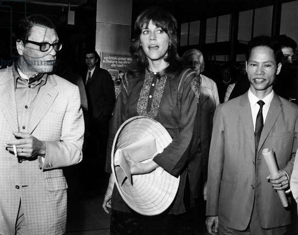 Jane Fonda (center) arriving in Paris after trip to North Vietnam greeted by Vu Van Xung (right) of North Vietnam legation, 7/23/72