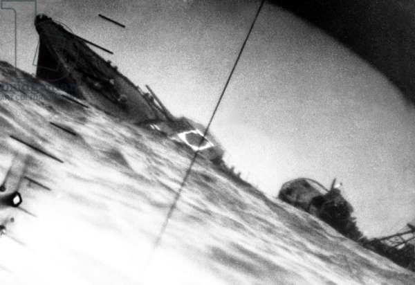 Torpedoed Japanese destroyer seen through periscope of USS Wahoo or USS Nautilus during World War 2. June 1942