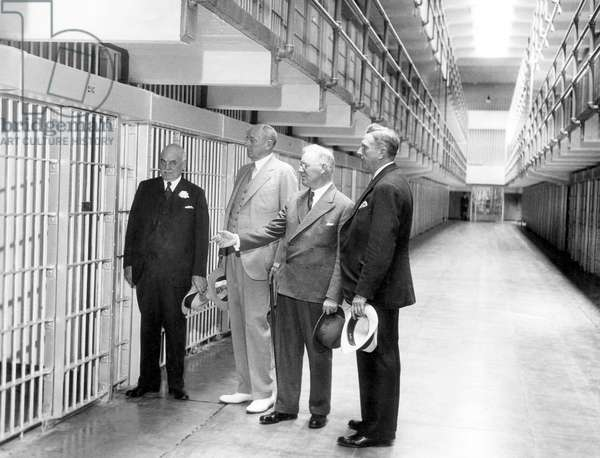 The newly built Alcatraz Federal Penitentiary receives official approval. From left: San Francisco Mayor Angelo Rossi, Attorney General Homer S. Cummings, Warden James A. Johnston, Police Chief William J. Quinn, San Francisco, August 20, 1934.