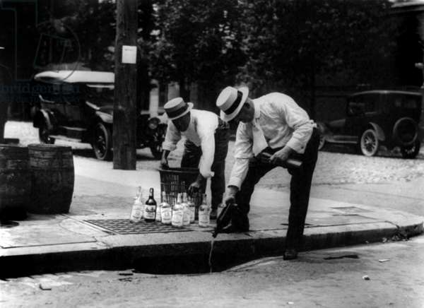 Prohibition: Prohibition, pouring whiskey into a sewer, circa 1909-1932.