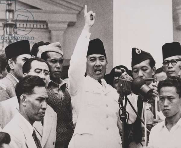 Indonesian President Sukarno, trying to calm thousands of angry demonstrators. Sept. 1950. The crowd demanded the dissolution of Parliament and general elections. Sukarno promised elections as soon as possible, which turned out to be Sept. 29, 1955.
