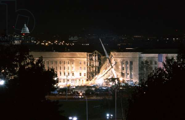 The huge 20 x 38 feet American flag is to the right of the damaged area of the Pentagon on the night of Sept. 12 2001. The previous day Al-Qaeda terrorists crashed hijacked American Airlines flight 77 jetliner into the building,