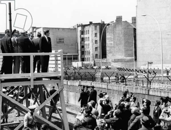 President John Kennedy in Berlin. On a specially erected platform, JFK views the communist wall which separates East and West Berlin. July 26, 1926