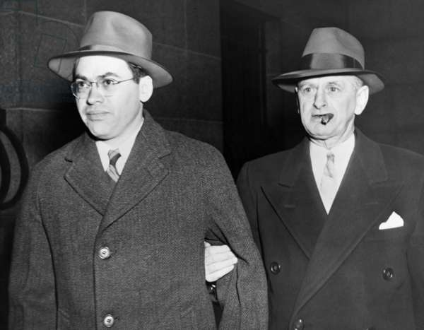 Morton Sobell left is escorted by a U.S. Marshall from City Prison to Federal Court March 6 1951. Sobell was tried with Julius and Ethel Rosenberg for conspiracy to commit espionage by passing atomic secrets to Soviet Russia